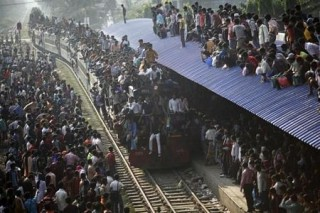 Andrew Biraj, a Reuters photographer based in Bangladesh, has won the 3rd Prize Daily Life Single category with this picture of an overcrowded train approaching a station in Dhaka November 16, 2010. The prize-winning entries of the World Press Photo Contest 2010, the world's largest annual press photography contest, were announced February 11, 2011. REUTERS/Andrew Biraj (BANGLADESH - Tags: RELIGION IMAGES OF THE DAY)