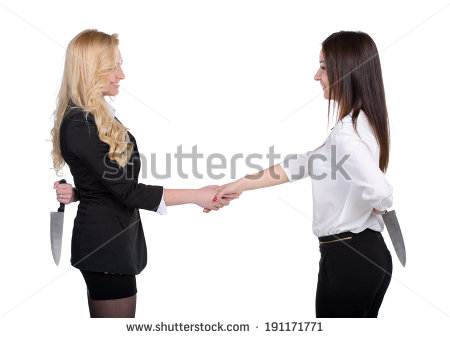 stock-photo-dishonest-partnership-two-young-business-woman-shaking-hands-and-holding-knifes-behind-their-backs-191171771