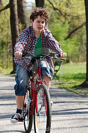 young-boy-cycling-19582420